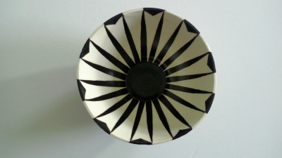 Slip cast bowl, glazed inside and out. The mono chrome geometric patterns on this bowl is reflected, so that the inside is the mirror image of the outside