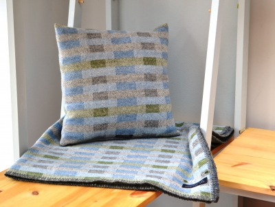 Madeleine jude handwoven lambswool lineal throw and cushion 2