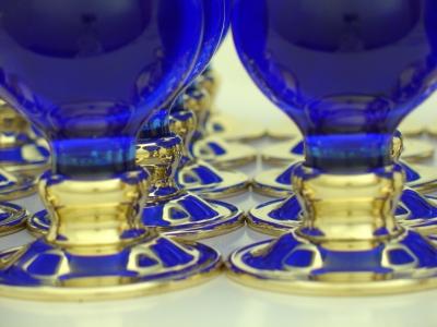 Cobalt blue balloons on brass