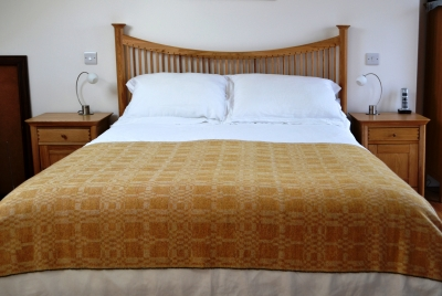 Madeleine jude coverlet throw yellow ochre handwoven in lambswool