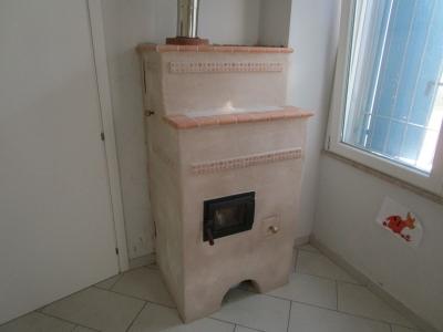 Andrea Magnolini, stufa intonacata in calce naturale
