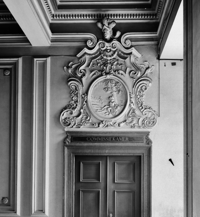 Town hall maastricht the netherlands. entrance to commissions chamber from main hall. stucco relief by tomaso vasali showing putto with coat of arms of brabant ca. 1735.
