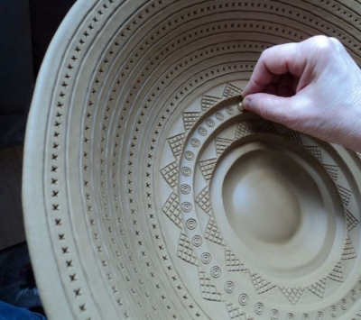 Stamping a celtic bowl from the Hallstatt period