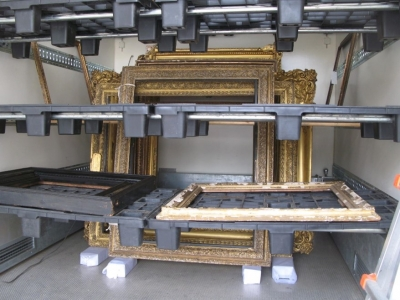Gilded picture frames in mobile treatment chamber
