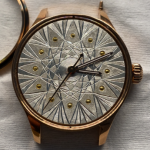 Watch dial with damasquinure
